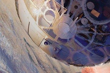 A spaceship descends through a planet's atmosphere.