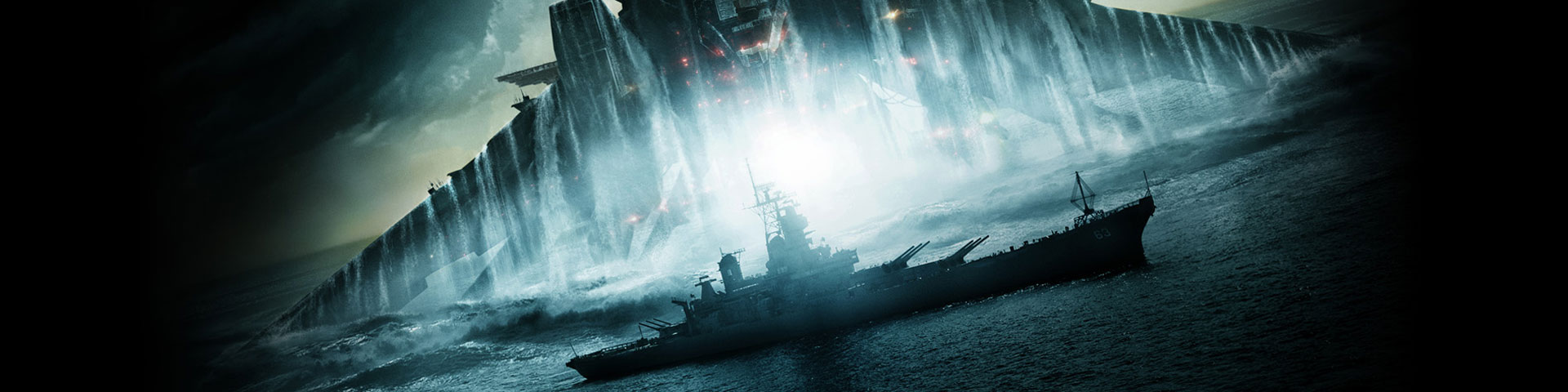 A large alien spaceship rises out of the ocean, looming over a battleship.