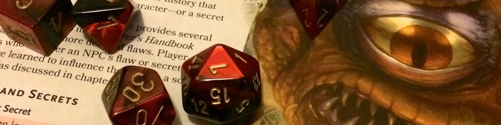 Red and black dice rest against a page of the Dungeon Master's Guide.