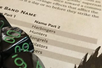 Green and grey dice rest on a page from Volo's Guide to Monsters