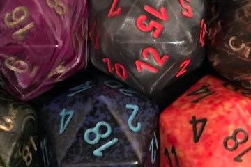 Two rows of different-colored twenty-sided dice.