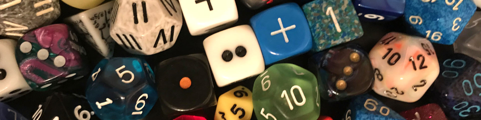 A collection of different sized and colored dice.