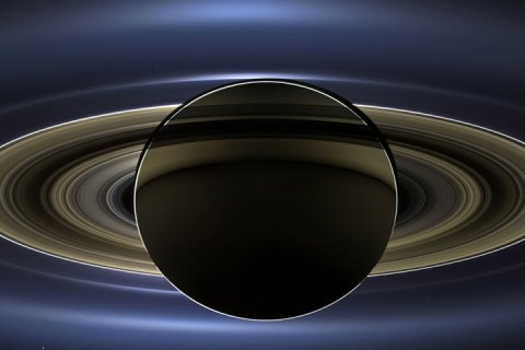 A view of Saturn backlit by the sun.