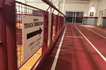 "An indoor track with the ""today's direction"" sign."
