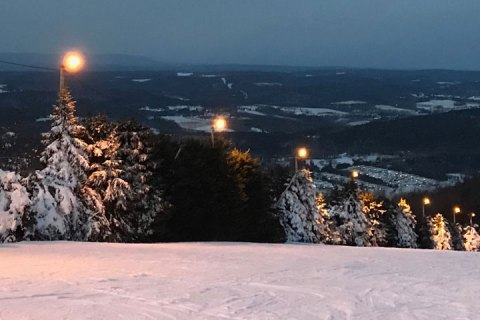 A view from the top of a ski sloop. The hills of Pennsylvania can be seen in the distance.