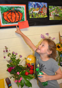 Tamsin Gurnell, 7, points to her first prize winning pumpkin picture.