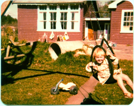 A young Rachelle hard at work on the swing.