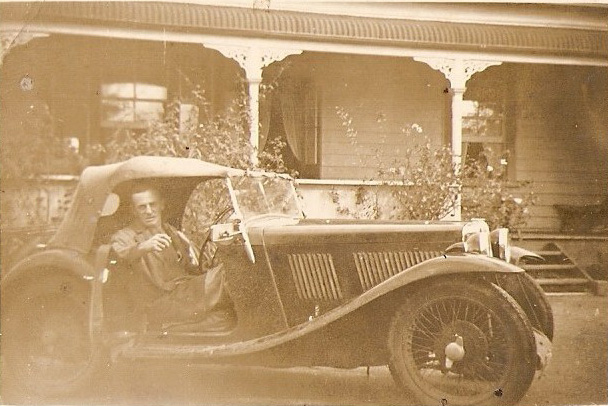 Photo of vintage MG outside the Taylor house