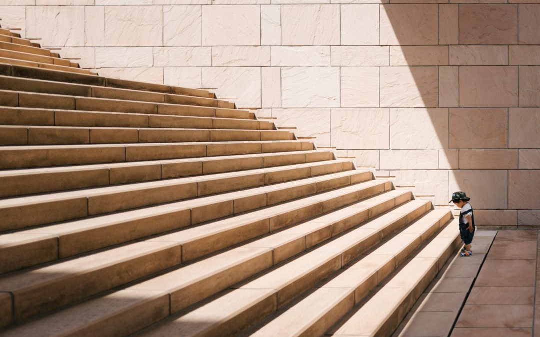 Child standing in front of huge steps; Numberslides offers one step at a time easy financial forecasting software