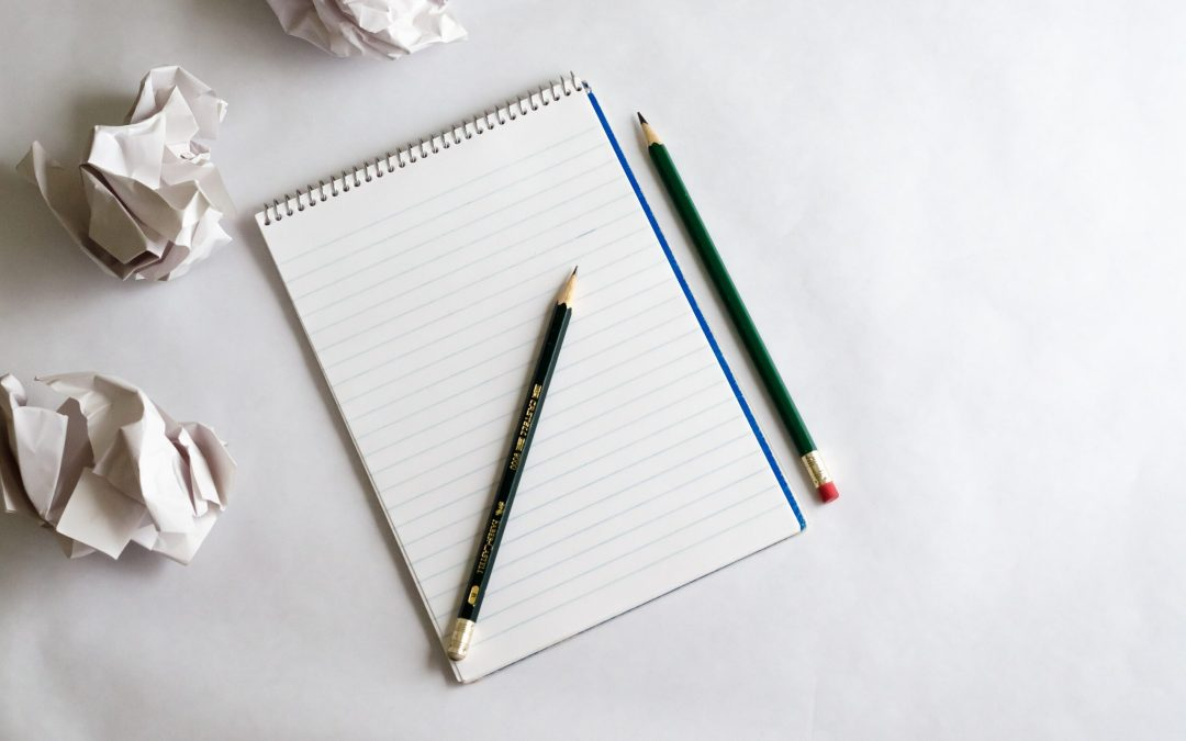 blank notebook with pencils representing 4 Important Things to Remember When Building Your Pitch Deck
