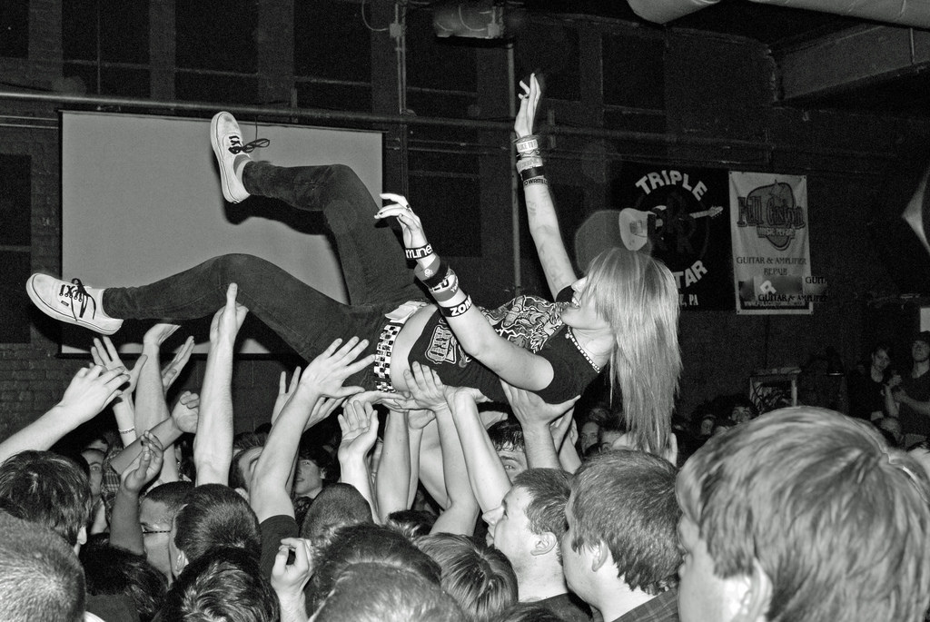 """friend-raising"" (image of crowd surfer)"