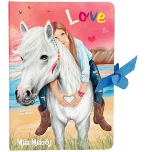 Päiväkirja, Miss Melody Ihana rusetilla avattava päiväkirja sailaisuuksille muistutuksille. Kirjassa on monta eri kokoista paperia