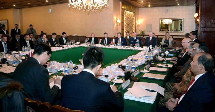 In this photo released by Associated Press of Pakistan, delegates from Pakistan, Afghanistan, China and United States attend third round of a meeting at the foreign ministry in Islamabad, Pakistan, Saturday, Feb. 6, 2016. China, the United States, Afghanistan and Pakistan launched their third round of talks Saturday aimed at finding a way to get the warring Taliban to sit and talk peace with the Afghan government. (Associated Press of Pakistan via AP)