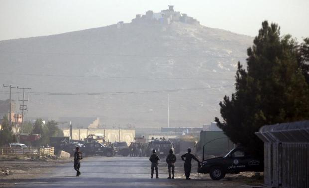 Afghan police guard around  a road leading to the site of an explosion, in Kabul, Afghanistan, Monday, Aug. 1, 2016. A strong explosion took place early Monday near a guesthouse for foreigners in Kabul, an Afghan police official said. (AP Photos/Massoud Hossaini)