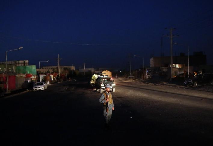 An Afghan police guards in the a road leading to the site of an explosion, in Kabul, Afghanistan, Monday, Aug. 1, 2016. A strong explosion took place early Monday near a guesthouse for foreigners in Kabul, an Afghan police official said. (AP Photos/Massoud Hossaini)