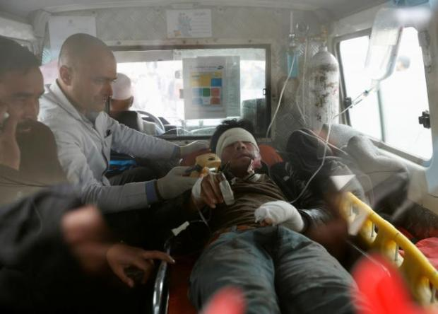 Men transport an injured person to a hospital after a suicide attack in Kabul, Afghanistan November 21, 2016. REUTERS/Mohammad Ismail
