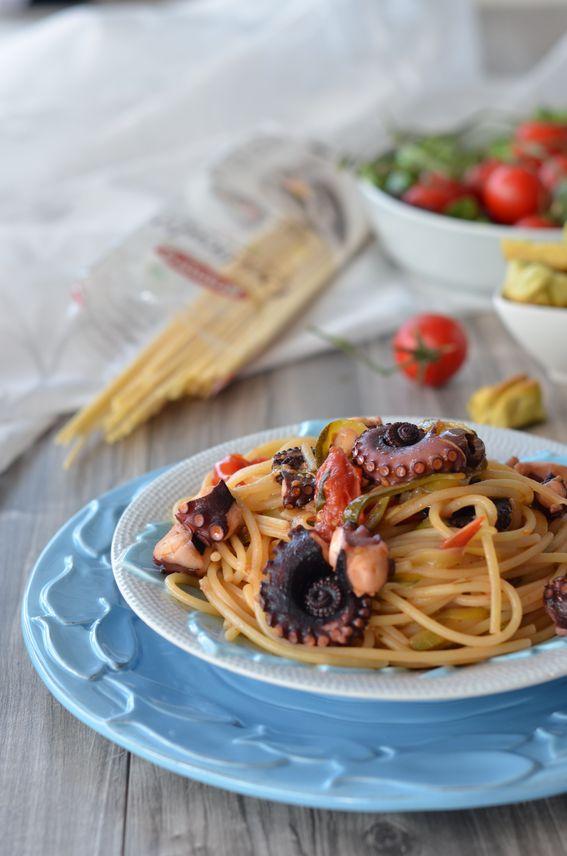 Spaghetti con pomodorini polpo e zucchine a filetti