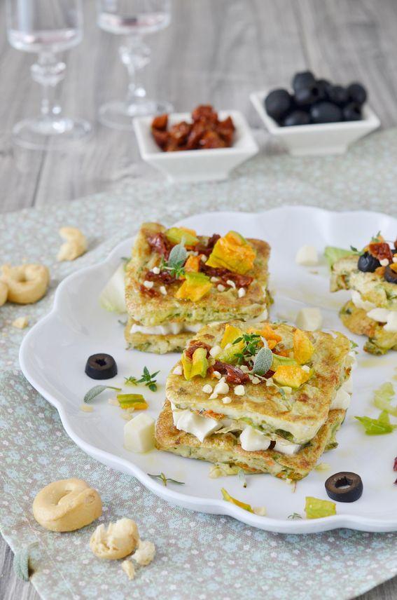 Frittatine di fiori di zucca con mozzarella e pomodori sott'olio