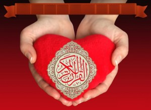 Quran on heart shaped pillow, red