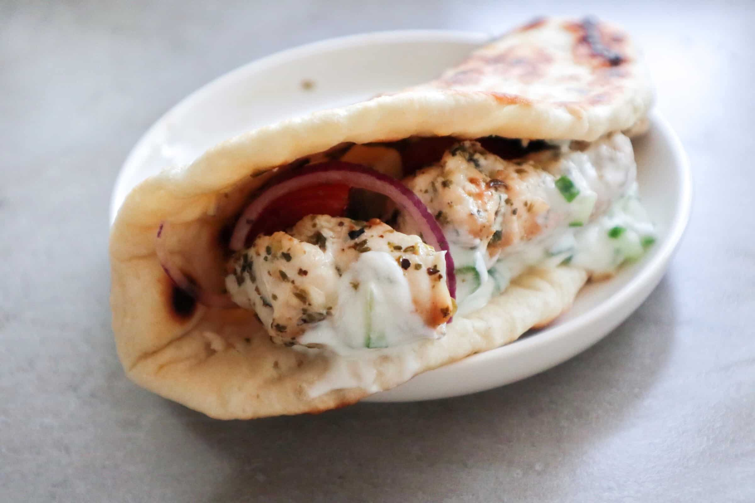 Close up Greek pita bread filled with chicken souvlaki
