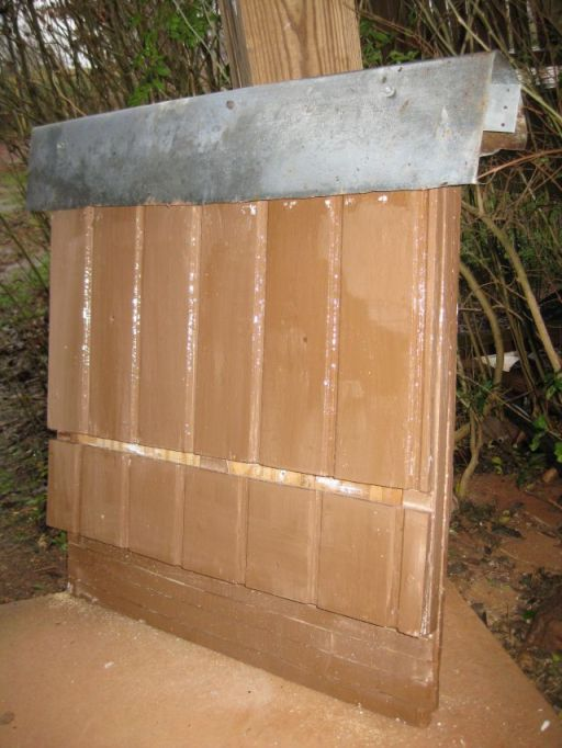 bat house with roofing material