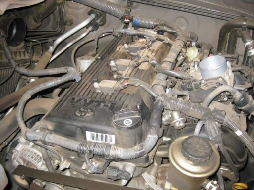 the engine with the intake air connector removed and the wires leading to the ignition coils exposed
