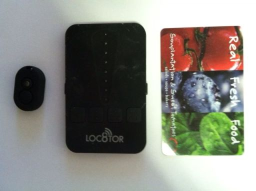 the locator is credit card sized and the transmitter on the left much smaller and worked for locating buried pipe