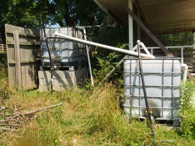 2 gravity feed tanks with numerous valves and pipes