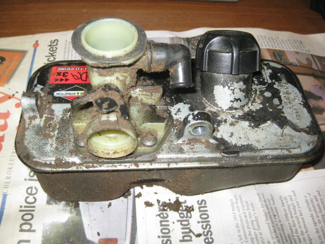 the carburetor and fuel tank before disassembly