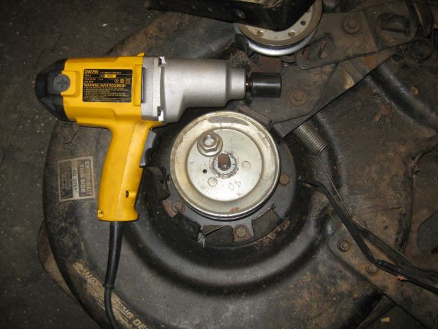 impact wrench, loosened nut and new pulley