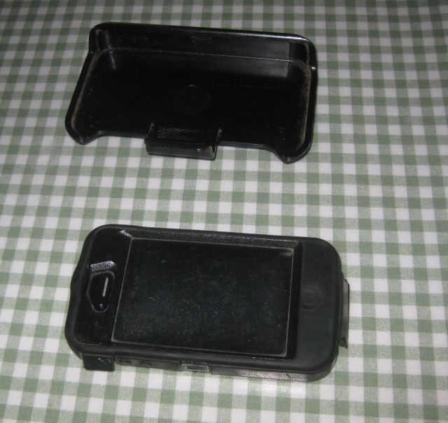 my current iPhone in weatherproof shell plus holster, both of which fit in my pocket