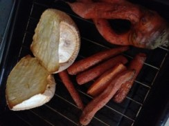 Roasted rutabaga and carrots in oven.