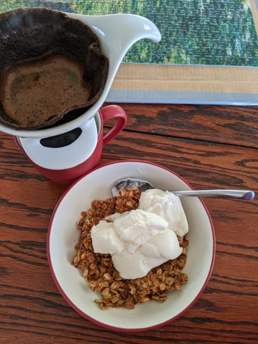 brewing coffee and a bowl of granola