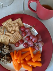 plate with crackers, meatballs, grapes, carrots
