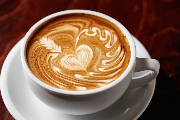 Fattening-looking coffee with a heart draw in the cream-foam.