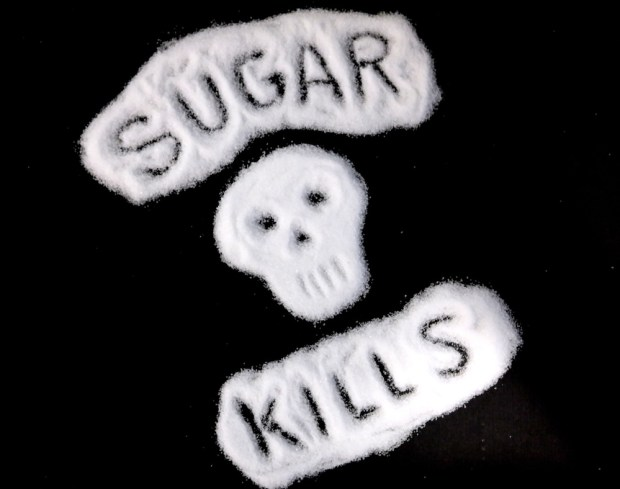 "A skull and the words ""sugar kills"" drawn with table sugar."