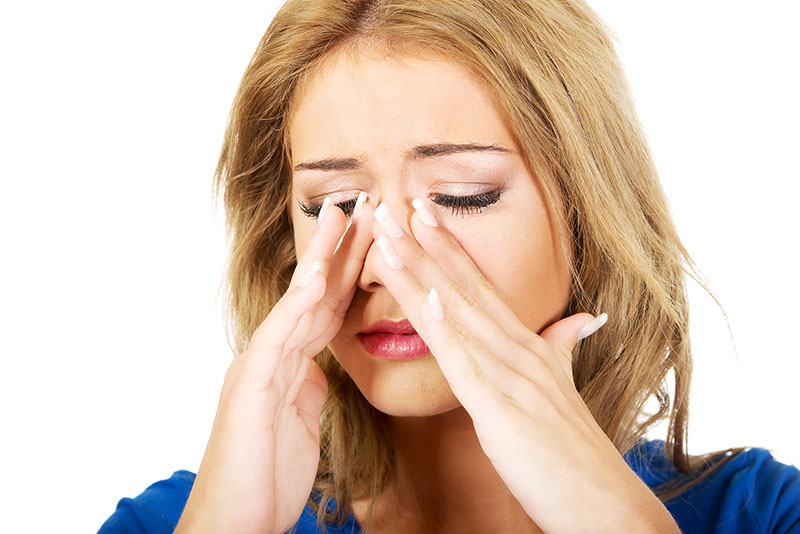 image of woman with sinus allergies