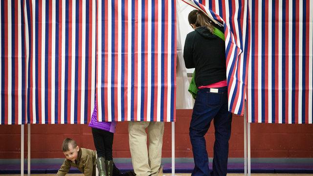 Voters vote in voting booth_1523382817498.jpg_359807_ver1.0_640_360_1527074534294.jpg.jpg