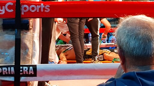 49f2ee1896b58 BEST QUALITY AVAILABLE – In this Sunday, July 21, 2019 photo, Argentine  boxer Hugo Santillan is placed on a stretcher after he collapsed at the end  of a WBC ...
