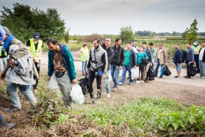GYEKENYES- OCTOBER 6 : War refugees at the Gyekenyes Zakany Railway Station on 6 October 2015 in Gyekenyes, Hungary. Refugees are arriving constantly to Hungary on the way to Germany.