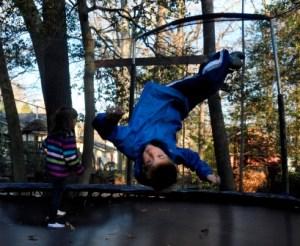 boys playing trampoline
