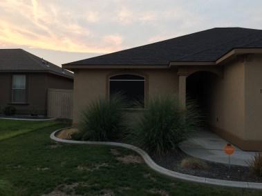 Dark Bronze Solar Screen on Stucco Home