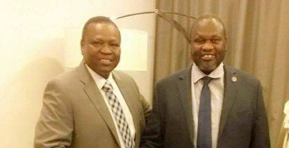 Cde Suliman Ali Dandara Dakota, SPLM-IO representative to Libya posting for a picture with Dr. Riek Machar(Photo: file)