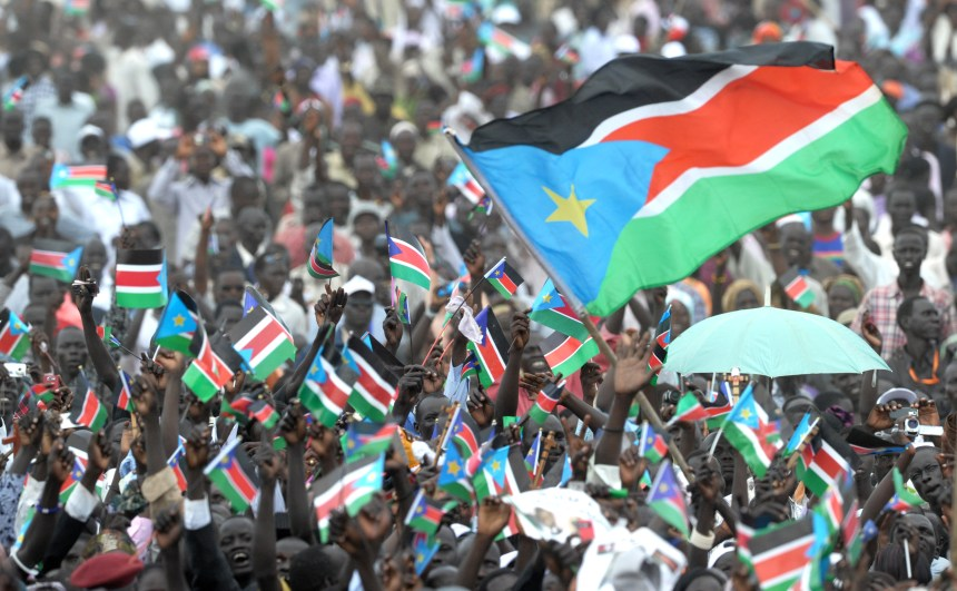 Thousands of Southern Sudanese wave the flag of their new country during a ceremony in the capital Juba on July 09, 2011 to celebrate South Sudan's independence from Sudan. South Sudan separated from Sudan to become the world's newest nation. AFP PHOTO/Roberto SCHMIDT (Photo credit should read ROBERTO SCHMIDT/AFP/Getty Images)