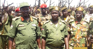 Maj. Gen. Mabieh Ghar(midle), the Overall Commander of SPLA-IO Division 8 in Yei River State posting for a picture in the past in Northern Upper Nile before transferred to Equatoria(Photo: file)