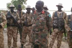 Maj. Gen. Buay Rolnyang and his soldiers at the front line in the past...