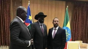 Rebel leader Dr. Riek Machar Teny (L) South Sudan President Salva Kiir Mayardiit (C) and Ethiopian Prime Minister Dr. Abiy Ahmed (R) posting for a photo after the face-to-face meeting in Addis Ababa, Ethiopia on 20th June 2018 (File photo)