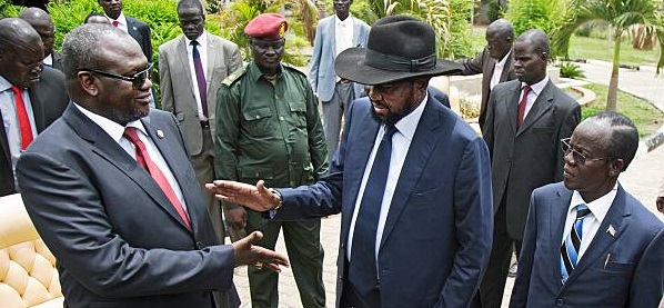 Former First Vice President of South Sudan and rebel leader Riek Machar (L) shakes hands with South Sudan President Salva Kiir (C), flanked by Second Vice President of South Sudan James Wani Igga (R), after the formation of the new cabinet of the Transitional Government at the Cabinet Affairs Ministry in Juba on April 29, 2016. (Photo Credit: ALBERT GONZALEZ FARRAN/AFP/Getty Images)