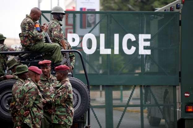 Members of Kenyan polices blocked a road in Kenya...