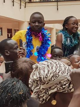 MAARNAATH PETER CHABAK from Mirema School in Nairobi who scored 417 marks out of 500 marks being carried by relatives and friends(Photo: file)